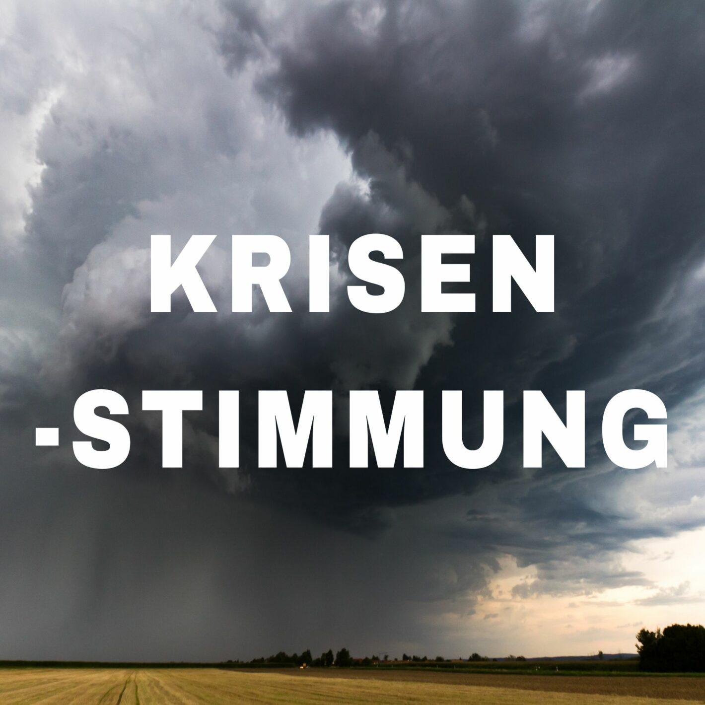 """Das Wort """"Krisenstimmung"""" vor einem düstern Hintergrund"""